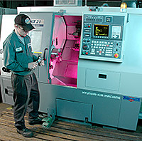 employee working on CNC machine